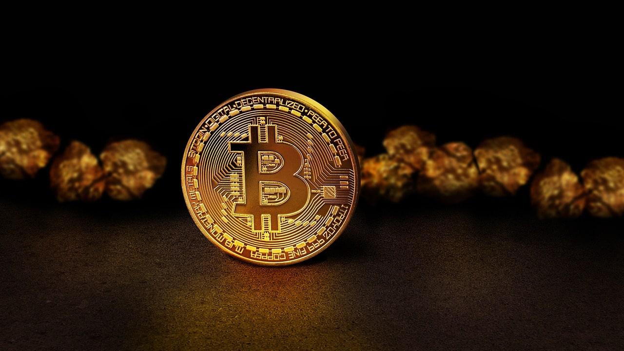 Em uma crise financeira, comprar ouro e/ou Bitcoin?