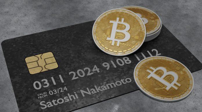 Cartão com nome de Satoshi Nakamoto e Bitcoin